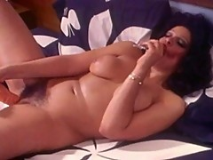 Slut fills a big dildo with cum