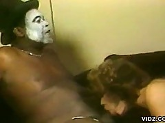 Skinny bitch fucks a guy with a painted face