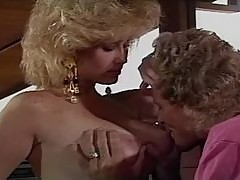 Betty Jean Bradley sucks Randy West's cock and lets him cum on her face