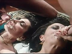 Retro video with two curly girls getting fucked and facialed